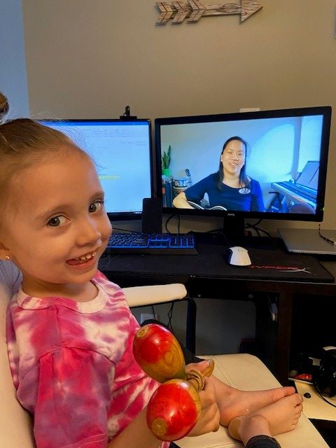 Pacekids student doing virtual music therapy from home