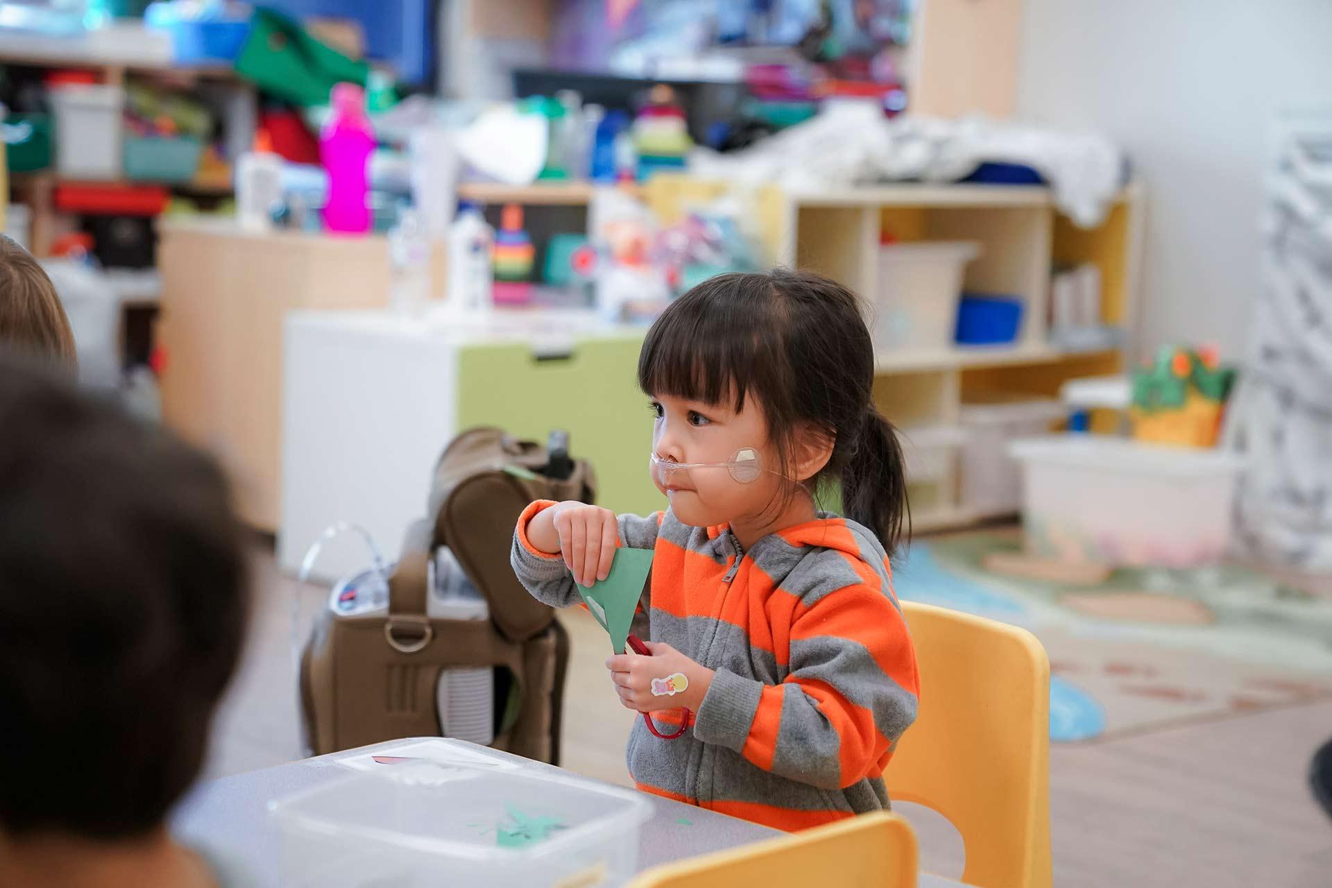Special Needs Child Using Scissors