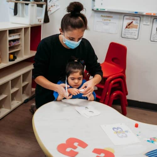 Image of Pacekids Staff working with child